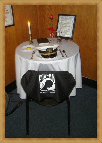 As you entered the dining area you may have noticed a table at the front raised to call your attention to its purpose. & VFW Post 1383 POW/MIA Table